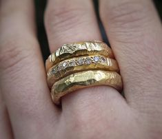 375 9ct Yellow Gold Gneiss Rings stacked around a 375 9ct Gneiss Pavé Ring…