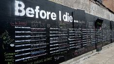 Before I Die; a chalkboard painted on the side of a derelict building in New Orleans.