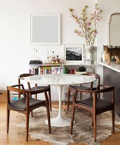 Retro Dining Room for us a large oval with warm marble and similar chairs