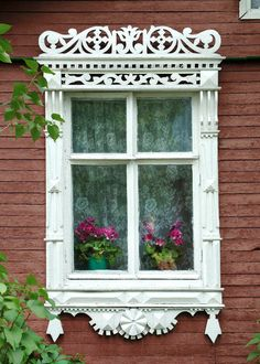 Decorative Russian Window Photography. Woodwork. Dacha, cabin. Ancient architecture. White. Pink flowers. Russia.