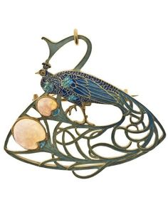 An Art Nouveau 'Peacock' pendant/brooch, by René Lalique, circa 1897/1898, France, composed of gold, enamel and opals. #ArtNouveau #Lalique #pendant #brooch