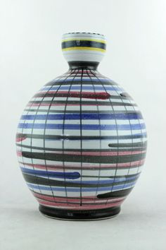 a rare 1950 s Rye pottery vase. Hand painted. Multi coloured. Red clay. English