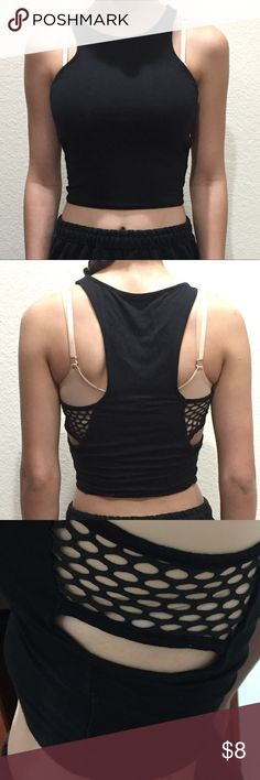 Fashion Nova black crop top This is a a cute black crop top from fashion nova with cute designs on its sides. It's cute to rock under overalls or something to wear with high waisted shorts. Looks good on anything bc it's black :) Fashion Nova Tops Crop Tops