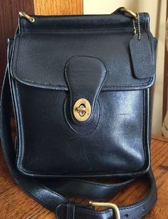 Dooney & Bourke Black With Brown Trim All Weather Leather Hobo ...