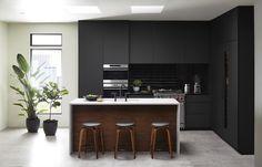 NEW from NC, this is FENIX NTM! Cabinets in matte black & island panel in black walnut wood veneer