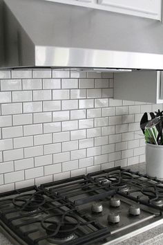 Gray grout with white subway tiles helps keep the kitchen from being whitewashed. Gray grout with white subway tiles helps keep the kitchen from being whitewashed. White Kitchen Backsplash, Subway Tile Kitchen, Kitchen Redo, New Kitchen, Backsplash Ideas, Backsplash Tile, Tile Ideas, Kitchen White, Tile Grout