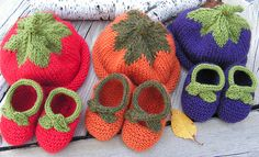 Fruit hats and matching booties. Photo has links to free hat and bootie patterns; fall harvest knit baby sets {explored} by saganaga on Flickr.