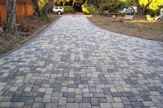 A modern driveway style can improve the curb appeal of your house. Some of the most popular types of modern driveway products in usage for high-end houses Driveway Paving Stones, Driveway Landscaping, Concrete Driveways, Modern Landscaping, Driveway Ideas, Paving Slabs, Landscaping Ideas, Sandstone Paving, Paving Ideas