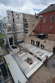 Commissioned by the Barbican, 'Dalston House' is the new gravity-defying illusion installation by Argentine artist Leandro Erlich that invites visitors to walk on the facade of a Victorian building. Land Art, Street Art, Art Du Monde, Instalation Art, Interactive Art, Interactive Installation, Art Plastique, Public Art, Urban Art