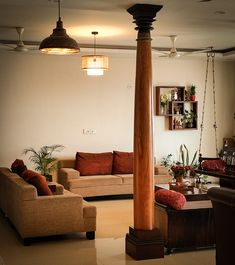 8ft wooden pillars, green plants and traditional swing decorated in the living room, Home Tour: A beautiful Antique Modern home in Bangalore ~ The Keybunch Decor Blog Makes You Beautiful, Beautiful Homes, Wooden Pillars, Brick Cladding, Vintage Trunks, Stone Flooring, Green Plants, Decorating Blogs, House Tours