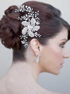 I'm not really interested in a veil, but I think a big, extravagant hair comb like this would be fun.