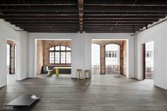 white walls and brick walls, wooden floor, little concrete and this is heaven for me! :)