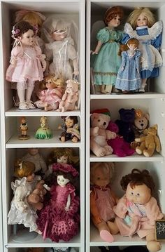"""Item # 1 -- Dolls, some porcelain, over 40 total, large & small, featuring NEW Shirley Temple doll. Some boxes incl-see photos. Smallest doll approx 4""""H (Hummel-like); tallest doll approx 24.5""""T (green dress). Located on 2nd floor. Shelving not incl."""