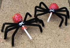 Lolly Pop Spiders. Take 4 Pipe Cleaners  together and bend in half. Take the Lolly and place in bend of Pipe Cleaners and twist around Lolly stick. Spread and make 4 legs on each side of Spider. Bend the end of the legs to help it stand. Add googley eyes or make eyes out of Candy of choice.