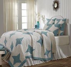 Summerhill Quilt Collection - The quilt is a teal and crème chambray, a modern twist of a classic quilting pattern of 4 point stars. The back is solid crème. It has 100% cotton shell and is hand quilted with stitch in the ditch and echo quilting. Luxury King $198.95, King $137.95, Queen $119.95, Twin $89.95