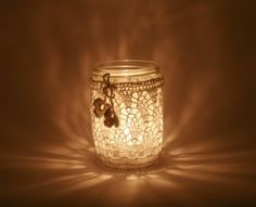 Repurposed jar with doily cover for icon corner light