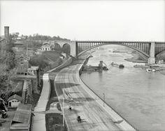 """Harlem River Speedway and Washington Bridge viewed from High Bridge."" New York ca 1905."