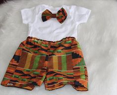 This listing is for an African fabric shorts and bowtie onesie. -This adorable set is perfect for special occasions, pictures or even everyday! - Items are also sold seperately. -This item is machine washable and can be tumbled dry or hung on the line. -All items are made in a smoke