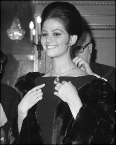 Who: Actress Claudia Cardinale Known for: After winning a trip to Italy in a beauty pageant, Cardinale quickly landed movie roles, becoming one of the best-known Italian actresses of her time. She used her fame to speak out for women's rights and in 2000 was named the UNESCO Goodwill Ambassador for the Defense of Women's Rights. Get the look: Complement a dramatic updo with bold jewelry and a textured coat.    - ELLE.com