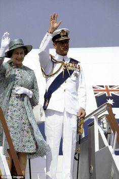 Elizabeth ll and Prince Philip, Duke of Edinburgh, wearing tropical white naval uniform, a...