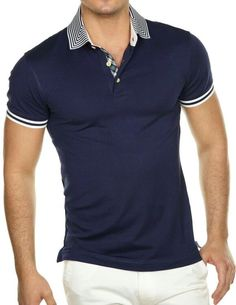 new product 5935c f0e98 Navy polo shirt with white stripes on the collar and cuff.