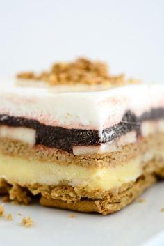 frozen ice book cake (graham crackers, vanilla pudding, chocolate pudding, banana, whipped cream)