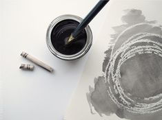 Just draw some lines, circles or write a text with a white crayon on a piece of watercolor paper. Then you take a brush and some color and swipe the brush over your pattern. And you´re done!