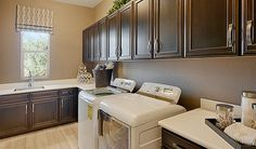 Warm wood cabinets, elegant flooring and a light-filled window… You might actually look forward to sorting laundry in this Las Vegas, NV, home!   Robert plan by Richmond American