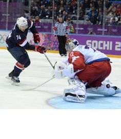 What a shootout! T.J. Oshie, of team USA men's hockey, scores on Sergei Bobrovsky, goalie for team Russia, in a shootout that lasted eight rounds, six of which Oshie took part of.
