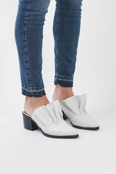 The mules get a fancy update in this quirkly style. In a sleek white leather, they come with pretty frill detail to the front and a rounded toe.