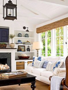 Traditional Living - like the bookcase styling with the lights over them; sofa inspiration!