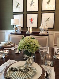 Green and White table setting. Green Grasscloth wallpaper. Bird paintings.