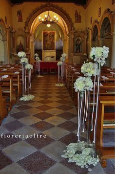 Fioreria Oltre/ Wedding ceremony/ Church wedding flowers/ Aisle decor for church wedding/ White cymbium orchids, white roses, lisianthus, hydrangeas Church Wedding Flowers, Altar Flowers, Wedding Flower Packages, Church Wedding Decorations, Religious Wedding, Flower Arrangements, Wedding White, White Roses, Pew Bows