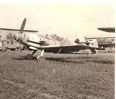 Me-109G after capitulation, see the 2 seater Do Pfeil with USAF markings in the background