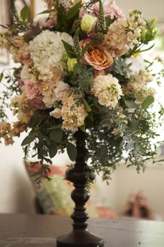 A rustic mock up of garden roses, dahlias, stock, hydrangea and more. The Little Branch