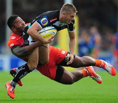 Exeter's Gareth Steenson gets caught by Manu Tuilagi