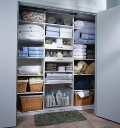 Linen closet organization. storage closet. Spare second bedroom. Glider shelves and drawers