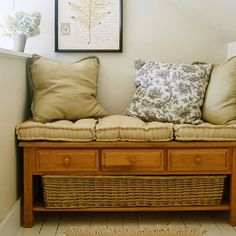 Make an entryway bench by repurposing a coffee table with cushions and a basket.