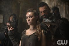 """The 100 -- """"Fog of War"""" -- Image: HU206b_0460 -- Pictured (L-R): Alycia Debnam-Carey as Lexa and Aleks Paunovic as Gustus -- Photo: Cate Cameron/The CW -- © 2014 The CW Network, LLC. All Rights Reserved"""
