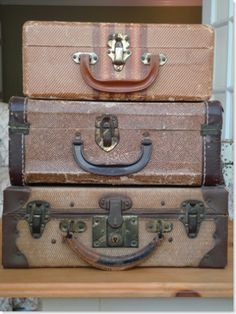 Stacked vintage suitcases.  <3