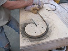 http://www.brainright.com/Projects/GardenMetalwork/Folly/ Not so tough- ifff you have the elbow grease.. right?  DIY Scroll Bending Jig