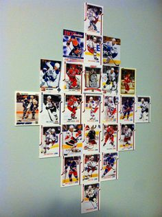 Bought hockey cards from Target, glued them to a white board, cut them out with a straight blade, hung on his bedroom wall.