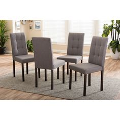 For a touch of chicness to your space, the Andrew Grey Fabric Upholstered Grid-tufting Dining Chair Set makes for a great choice