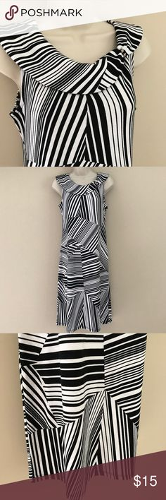 """Black & White Geometric Dress Beautiful black and white dress. Cool pattern. 100% cotton, machine wash. Measures 19"""" across the bust, 17"""" across the waist (material has plenty of give and can stretch beyond these measurements). 40"""" total length. Bundle and save! Rafaella Dresses"""