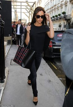 Victoria Beckham looked effortlessly chic in a black caped top and dark skinny jeans http://dailym.ai/X8TJob