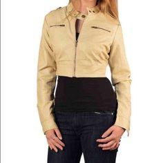 Short jacket Front zip, twin button neck. Beige. Model is wearing a small. Model measurements bust 34, waist 26. 100% polyurethane. Med 5/9 Jackets & Coats