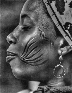 Beautiful scarifications - (photographer?) I personally done care to partake of this art form but I acknowledge that it can be lovely on tribal cultures.