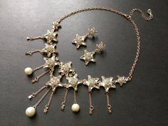 Excited to share this item from my shop: Dangly stars necklace, chandelier necklace, wedding necklace, rhinestones crystals necklace, wedding jewelry, bridal jewelry, jewelry set #rosegold #wedding #classic #weddingset #starsnecklace #danglynecklace Star Necklace, Crystal Necklace, Crystal Rhinestone, Bridal Necklace, Wedding Jewelry, Star Pendant, Wedding Sets, Jewelry Sets, Hair Accessories
