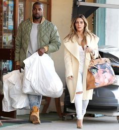 Kim Kardashian Shows Off Birkin Bag Covered in Nude Paintings From Fiance Kanye West: Pictures  Kanye West and Kim Kardashian on December 26, 2013 in Los Angeles