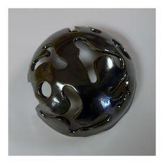 Molded carved bowl with metallic glaze by Elijah